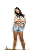 Poor Girl. Girl with a faraway look wrapped in a shawl and wearing jeans shorts.  Sad expression Stock Images