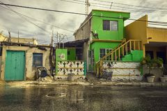 Poor green house. Beyond a narrow street: A detail of the poorest neighborhoods in Isla Mujeres stock photography