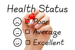 Poor Health Status Survey. Hand putting check mark with red marker on poor in Health Status evaluation form Royalty Free Stock Photography