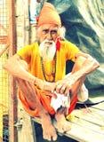Poor Hindu Saint. A poor Hindu saint traveling during a pilgrimage of Kumbh festival in India royalty free stock images