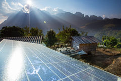 Poor Home and Solar panels. Royalty Free Stock Photography