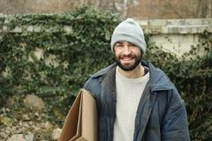 Poor homeless man with cardboard. On street royalty free stock images