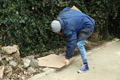 Poor homeless man with cardboard. On street royalty free stock photos