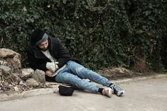 Poor homeless man lying on street. In city royalty free stock photos