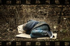 Poor homeless man sleeping on ground in park. Poor homeless man sleeping on ground in city park stock photography