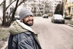 Poor homeless man standing on street. Poor homeless man standing on city street royalty free stock images