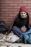 Poor, homeless man on the street Royalty Free Stock Image