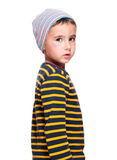 Poor homeless orphan child. Boy in striped sweater isolated on white Royalty Free Stock Photos