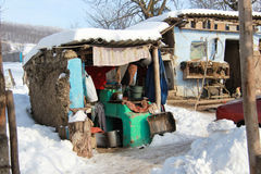 Poor house. A very poor house from a poor village in middle of winter in Vaslui - Romania royalty free stock images