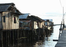Poor houses above sea. Poor fishers houses above sea during sunset in Sorong (Papua Barat, Indonesia Stock Images