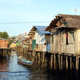 Poor houses above sea. Poor fishers houses above sea during sunset in Sorong (Papua Barat, Indonesia Stock Image