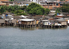 Poor houses built out over the water. In brazi royalty free stock photo