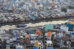 Poor houses in Ho Chi Minh Riverside cityscape view with Ben Nghe or Tau Hu canal in sunrise or sunset Royalty Free Stock Photo
