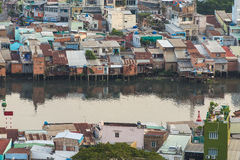 Poor houses in Ho Chi Minh Riverside cityscape view with Ben Nghe or Tau Hu canal in sunrise or sunset Royalty Free Stock Photos