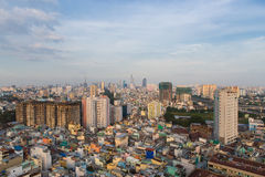 Poor houses in Ho Chi Minh Riverside cityscape view with Ben Nghe or Tau Hu canal in sunrise or sunset Royalty Free Stock Images