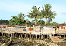 Poor houses and wreckage of boats Royalty Free Stock Photography
