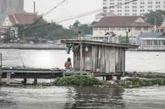 Poor hut on riverside. Taken from Bangkok Thailand Royalty Free Stock Image
