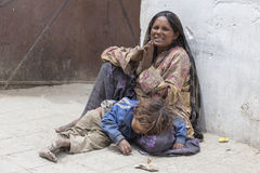 Poor Indian Beggar Family On Street In Ladakh. India Royalty Free Stock Photo