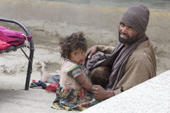 Poor Indian beggar family on street in Ladakh. India Stock Image