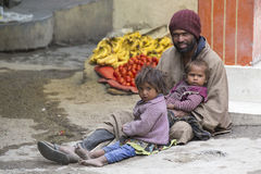 Poor Indian beggar family on street in Leh, Ladakh, India Stock Images
