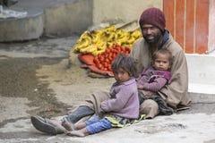 Poor Indian beggar family on street in Leh, Ladakh, India Stock Images