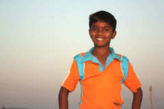 Poor Indian Boy. A portrait of a poor Indian village boy in the outdoors Stock Photography
