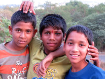Poor Indian Boys. A portrait of poor Indian boys posing together as friends Royalty Free Stock Photography