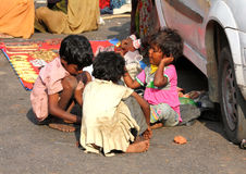 Poor indian chidren on town street. PUSHKAR, INDIA - NOVEMBER 20: Poor indian chidren on town street on November 20, 2012 in Pushkar, Rajasthan, India Stock Images