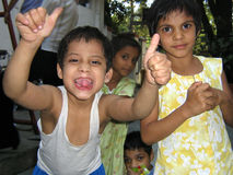 Poor Indian Children. Poor children from India having fun in front of the camera Royalty Free Stock Images