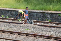 Poor indian children collecting waste on rails Stock Image