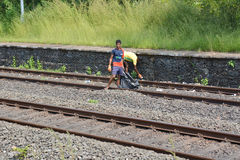 Poor indian children collecting waste on rails Stock Images