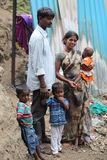 Poor Indian Family. A poor Indian family of father mother and three children standing at the construction site they work at Royalty Free Stock Photo