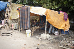 Poor Indian family living in a makeshift shack. VARANASI, INDIA - OCTOBER 28, 2014 : Poor Indian family living in a makeshift shack by the side of the road Stock Photos