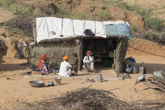 Poor indian family it is located near the huts in the desert. Pushkar, India Royalty Free Stock Photography