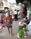 Poor indian man walking Stock Images