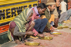 Free Poor Indian People Eating Free Food At The Street In Varanasi, India Stock Image - 94592131