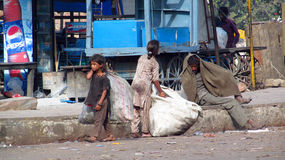 Poor indian people living in a shack in the city slum Royalty Free Stock Photography