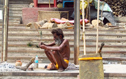 Poor indian people living in a shack in the city slum Stock Image