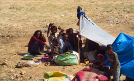 Poor indian people living in a shack in the city slum Royalty Free Stock Photo