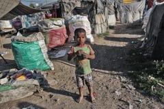 Poor kid at home home. Poor kid in the slum near Patiala , Punjab India Royalty Free Stock Image