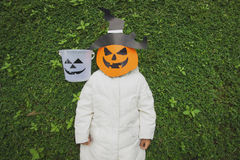Poor kids play Halloween with the mask Stock Image