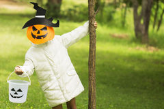 Poor kids play Halloween with the mask handmade Royalty Free Stock Photos