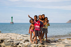 Poor kids posing on Dili beach Royalty Free Stock Photo