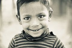 A poor kids smiling unique black and white photo. A poor Bangladeshi kids smiling unique black and white photo royalty free stock photography