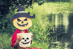 Poor kids want candy and play halloween with the mask handmade Stock Images