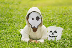 Poor kids want to play Halloween with the mask handmade Stock Photography