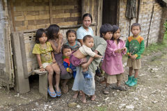 Poor laotian hmong children. In front of a house an the mainstreet to Luang Prabang Stock Photography