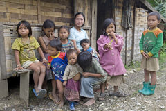 Poor laotian hmong children. In front of a house an the mainstreet to Luang Prabang Stock Images