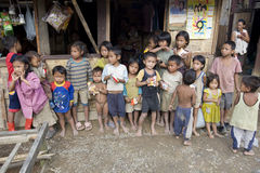Poor laotian hmong children. In front of a house an the mainstreet to Luang Prabang Stock Photo