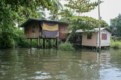 Poor life in the slums. Of Bangkok, Thailand, small slums on the river where living poor people n Royalty Free Stock Photo